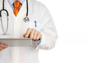 Doctor Pointing At Clipboard